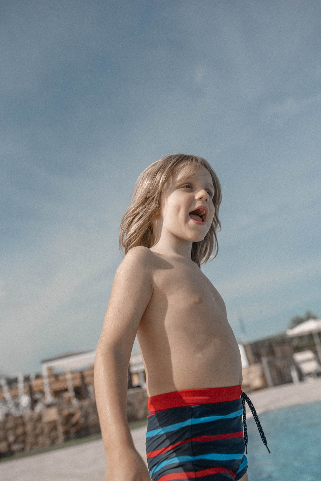 Travels with Autism - An Unofficial guide - Charlie by the pool in Sardinia