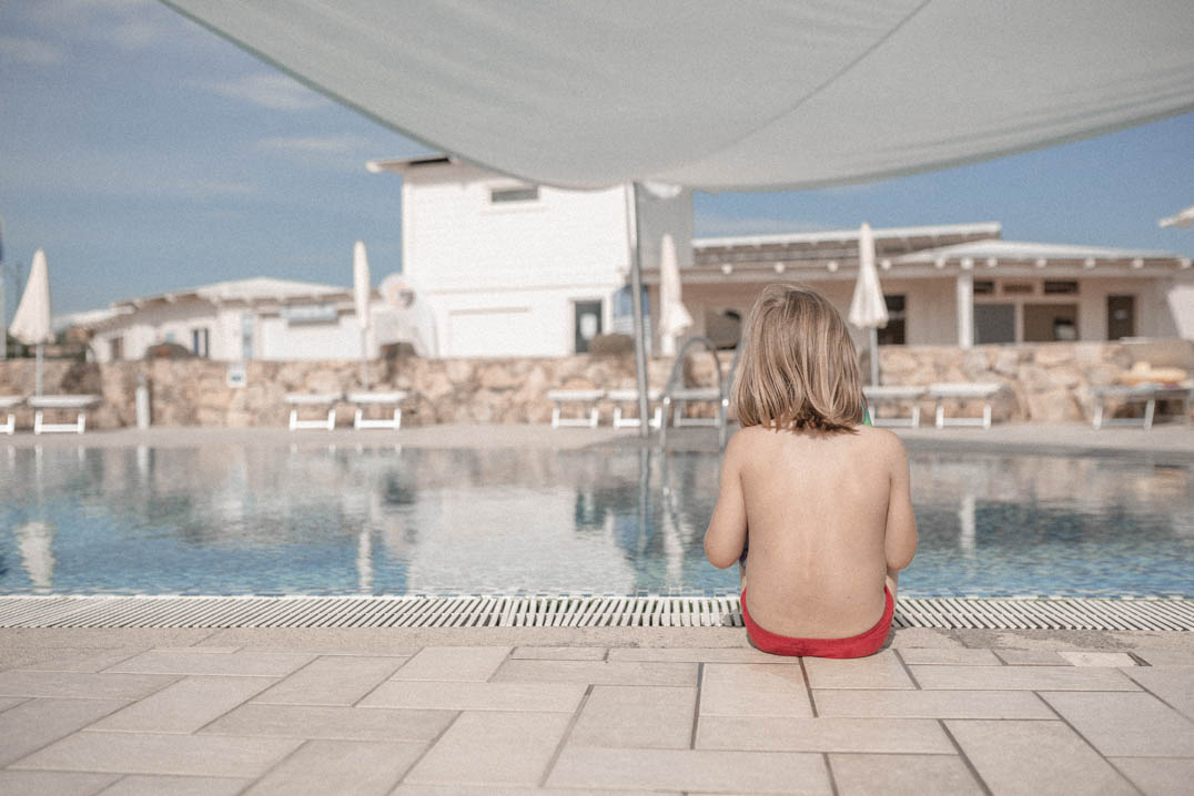 Travels with Autism - An unofficial guide - Charlie sitting by the pool